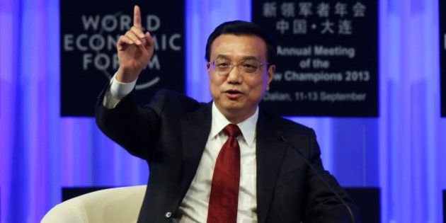 Li Keqiang, China's premier, gestures as he speaks during the opening plenary at the World Economic Forum...