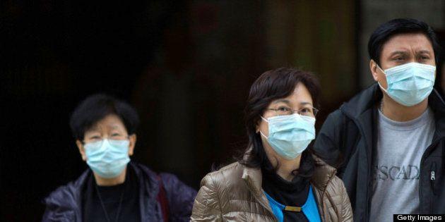 HONG KONG - APRIL 12: People wear face masks outside the Princess Margaret Hospital on April 12, 2013...