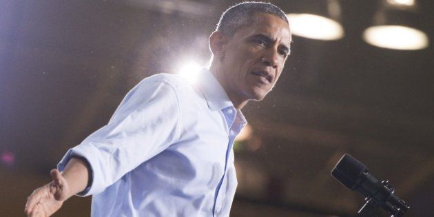 US President Barack Obama speaks at a Democratic campaign rally for US Senate candidate Gary Peters and...