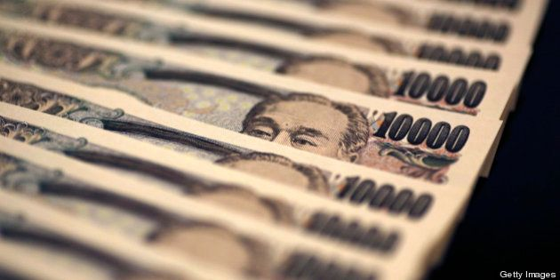 Japanese 10,000 yen banknotes are arranged for a photograph in Tokyo, Japan, on Monday, Feb. 25, 2013....