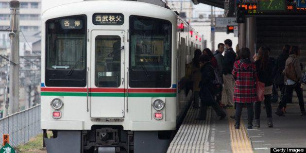 A Seibu Railway Co. train arrives at Seibu Chichibu station in Saitama, Japan, on Monday, March 25, 2013....