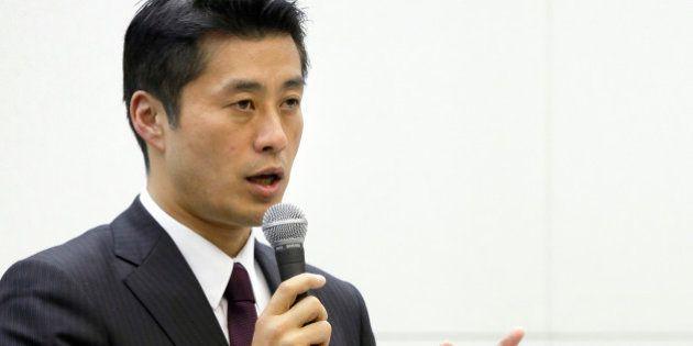 Goshi Hosono, Japan's environment minister, left, speaks as Toshio Nishizawa, president of Tokyo Electric...
