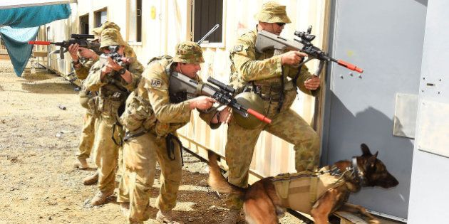 ROCKHAMPTON, AUSTRALIA - JULY 09: Australian soldiers from the 1st Military Police Battalion conduct...