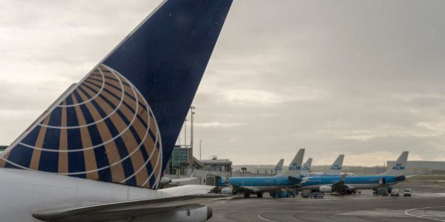 AMSTERDAM, NETHERLANDS - APRIL 23: A United Airlines and several KLM airplanes are parked on the tarmac...