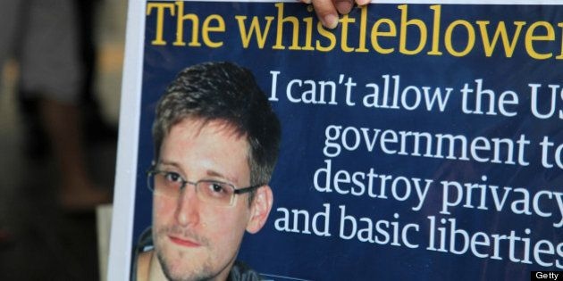 A protester holds a placard during a rally in support of Edward Snowden, the former National Security...
