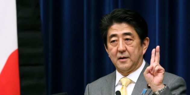 Shinzo Abe, Japan's prime minister, gestures as he speaks during a news conference at the prime minister's...