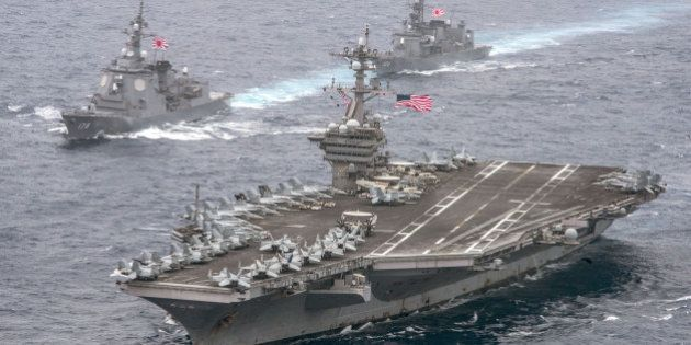 The U.S. Navy aircraft carrier USS Carl Vinson leads the Japan Maritime Self-Defense Force (JMSDF) Atago-class...