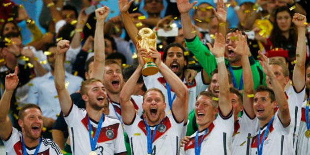 RIO DE JANEIRO, BRAZIL - JULY 13: Benedikt Hoewedes of Germany celebrates with the World Cup trophy after...