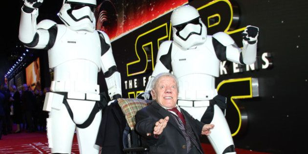 Kenny Baker, centre, poses for photographers upon arrival at the European premiere of the film 'Star...