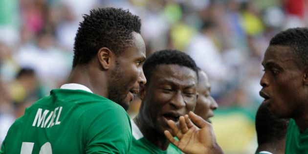 Nigeria's John Obi Mikel, left, celebrates his goal with teammates during a quarter-final match of the...