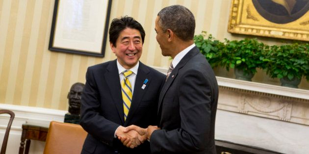 Shinzo Abe, Japan's prime minister, left, shakes hands with U.S. President Barack Obama in the Oval Office...