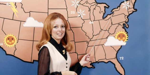 1970s WOMAN WEATHER GIRL METEOROLOGY METEOROLOGIST TELEVISION NEWS (Photo by H. Armstrong Roberts/ClassicStock/Getty