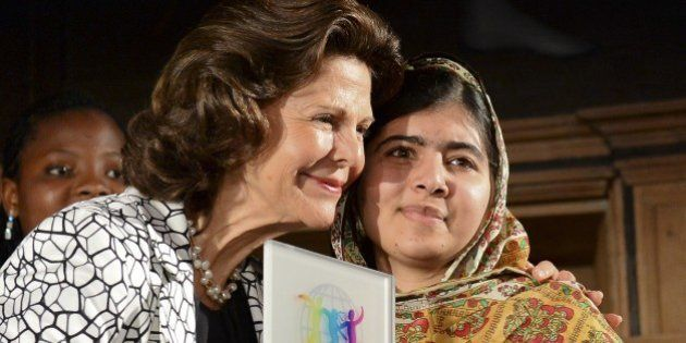 Pakistani activist for female education and Nobel Peace Prize laureate Malala Yousafzai (R) receives...