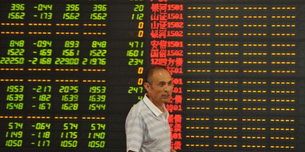 FUYANG, CHINA - JULY 08: (CHINA OUT) An investor observes stock market at a stock exchange hall on July...