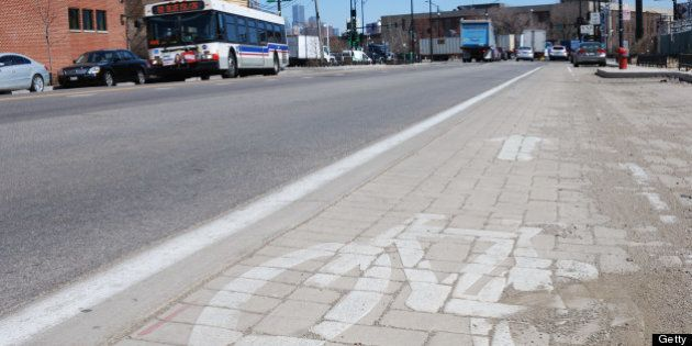 Smog eating paving stones form a bicycle lane on Blue Island Ave, which Chicago city officials havce...