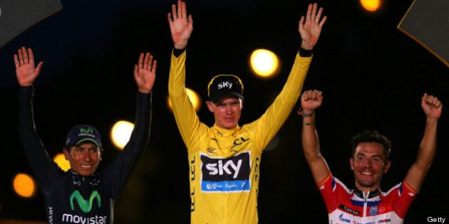 PARIS, FRANCE - JULY 21: Winner of the 2013 Tour de France, Chris Froome of Great Britain and SKY Procycling...