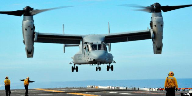March 1, 2011 - A U.S. Marine Corps MV-22 Osprey aircraft prepares to land on the flight deck of amphibious...