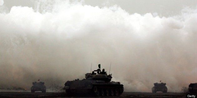 GOTENBA, JAPAN - AUGUST 23: Tanks fire shells during the annual Japan's Self Defense Forces live-firing...