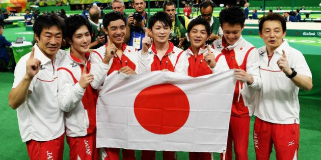 RIO DE JANEIRO, BRAZIL - AUGUST 08: Team Japan poses for photographs after winning the gold medal during...