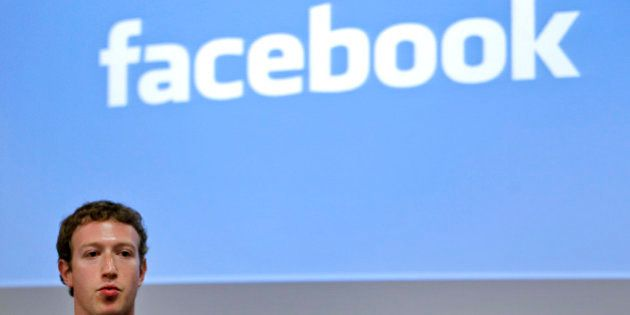 Mark Zuckerberg, founder and chief executive officer of Facebook Inc., speaks during a news conference...