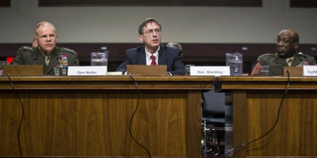 Sean Stackley, acting Secretary of the Navy, center, testifies while General Robert Neller, Commandant...