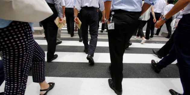 Office workers walk on a pedestrian crossing during a lunch break in Tokyo Monday, June 8, 2015. Japan's...