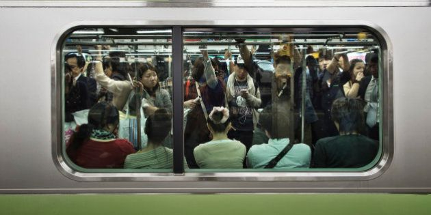 A crowded Tokyo Yamanote Line commuter train during a busy period on Saturday when people go out to