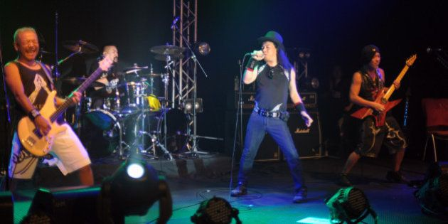 Japanese heavy metal band Loudness (L to R) bassist Masayoshi Yamashita, dummer Masayuki Susuki, singer...
