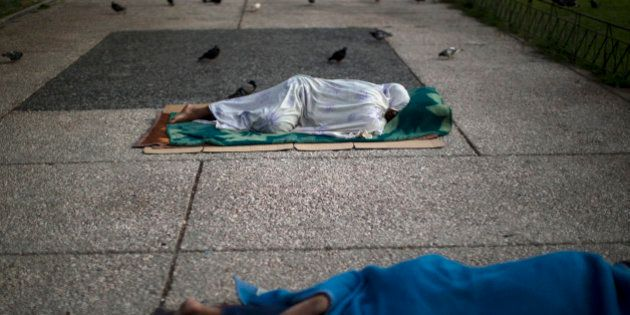 Homeless sleep on the ground in central Athens, Monday, July 6, 2015. Greece's finance minister has...