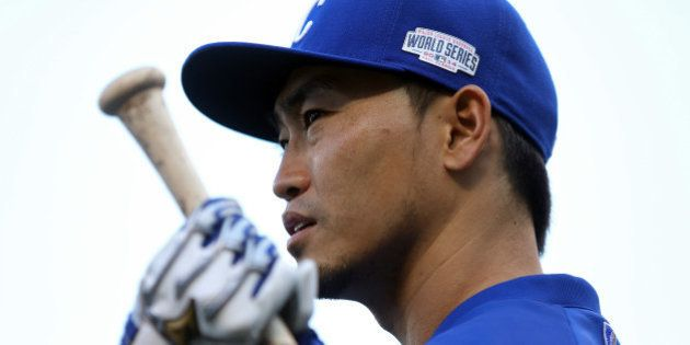 KANSAS CITY, MO - OCTOBER 22: Norichika Aoki #23 of the Kansas City Royals stands on the field before...