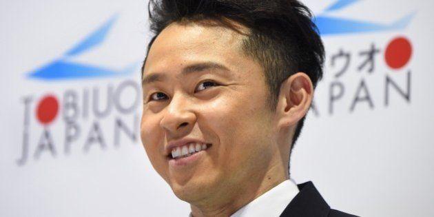 Japanese three-time world champion swimmer and former world record holder Kosuke Kitajima smiles as he...