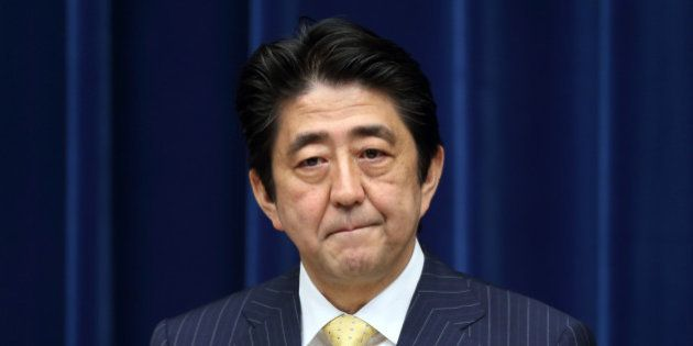 Shinzo Abe, Japan's prime minister, listens during a news conference at the prime minister's official...