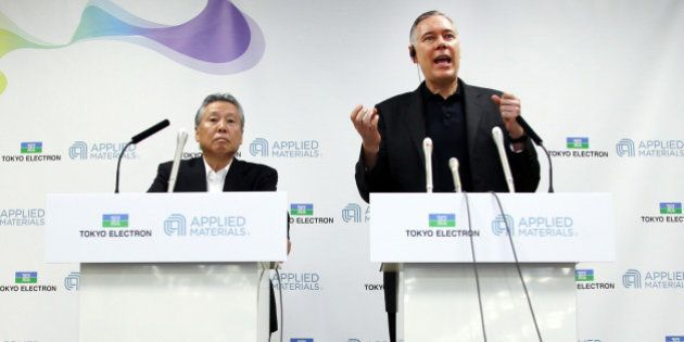 Gary Dickerson, chief executive officer of Applied Materials Inc., right, speaks as Tetsuro 'Terry' Higashi,...