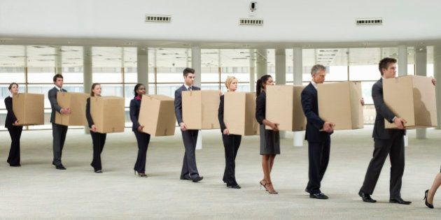 line of business people carrying cardboard