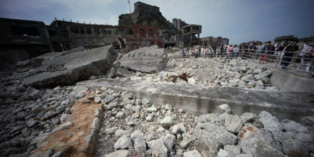 In this June 29, 2015 photo, forlorn buildings are seen at Hashima Island, commonly known as Gunkanjima,...