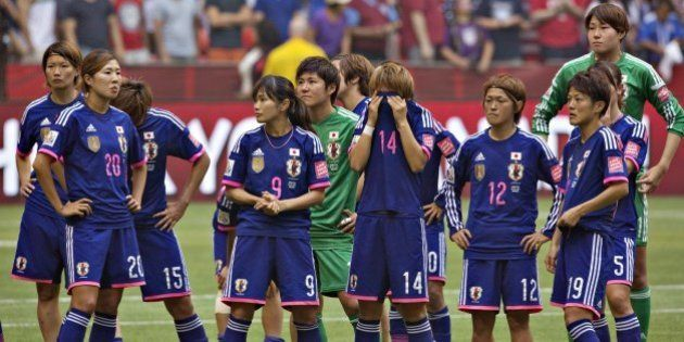 Members of the Japan team react to losing the championship match against the USA at BC Place Stadium...