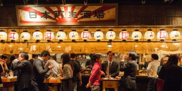 Customers dine at a pub in Tokyo, Japan, on Monday, Dec. 10, 2012. Japan's economy shrank in the last...