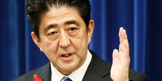 Shinzo Abe, Japan's prime minister, gestures during a news conference at the prime minister's official...