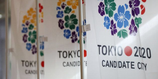 Flags promoting Japan's bid for the 2020 Olympics and Paralympic Games are displayed during a media tour...