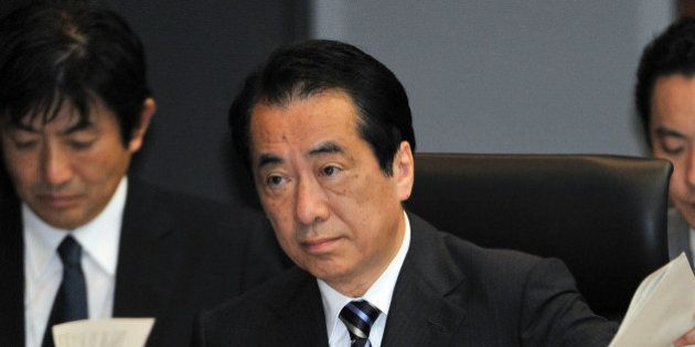 (FILES) This file picture taken on May 28, 2012 shows former Japanese prime minister Naoto Kan (C) speaking...