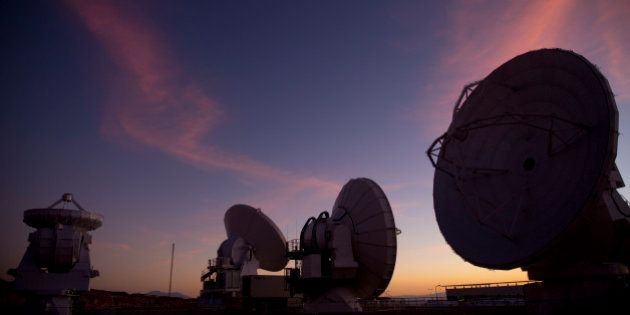 Radio telescope antennas of the ALMA ( Atacama Large Millimeter/submillimeter Array) project are seen...