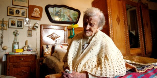 Emma Morano, thought to be the world's oldest person and the last to be born in the 1800s, sits on her...