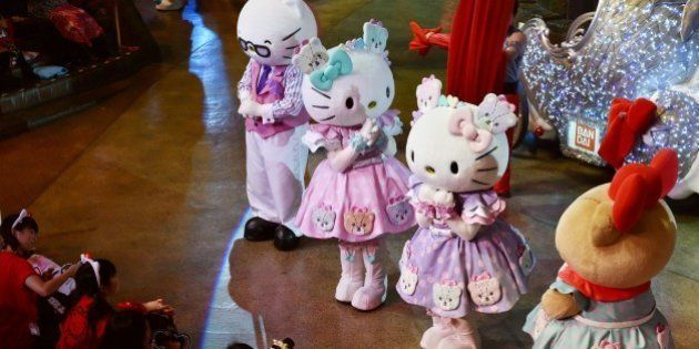 Hello Kitty (2nd R) and her twin sister Mimmy (3rd R) perform with Sanrio characters in the Hello Kitty...