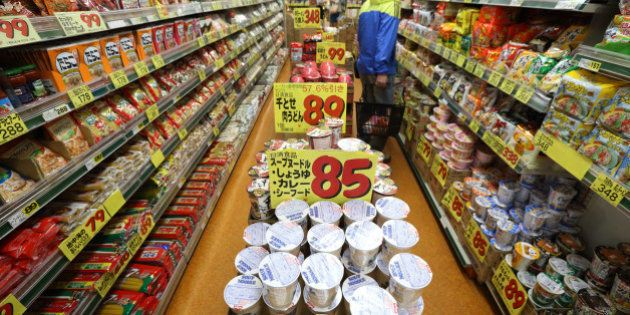 A customer walks through the noodle section at a supermarket in Tokyo, Japan, on Tuesday, April 9, 2013....