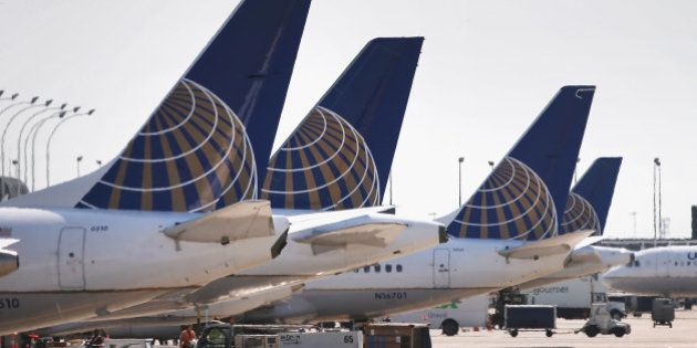 CHICAGO, IL - SEPTEMBER 19: United Airlines jets sit at gates at O'Hare International Airport on September...