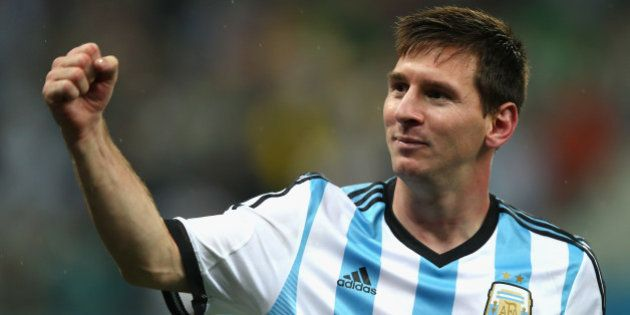 SAO PAULO, BRAZIL - JULY 09: Lionel Messi of Argentina celebrates defeating the Netherlands in a shootout...