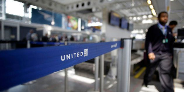 An airport worker walks through the United Airlines terminal at O'Hare International Airport on April...