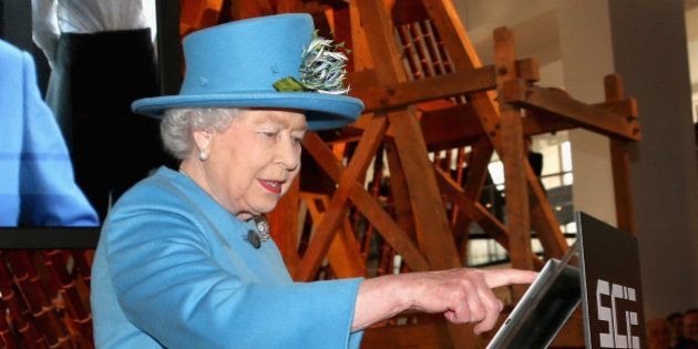 LONDON, ENGLAND - OCTOBER 24: Queen Elizabeth II sends her first Tweet during a visit to the 'Information...