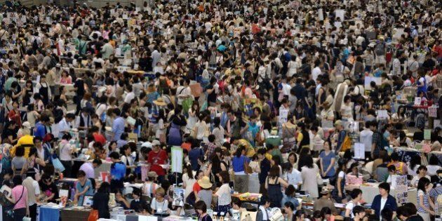 JAPAN - AUGUST 13: Comic Market In Tokyo, Japan On August 13, 2010 - Participants and fans of comics,...