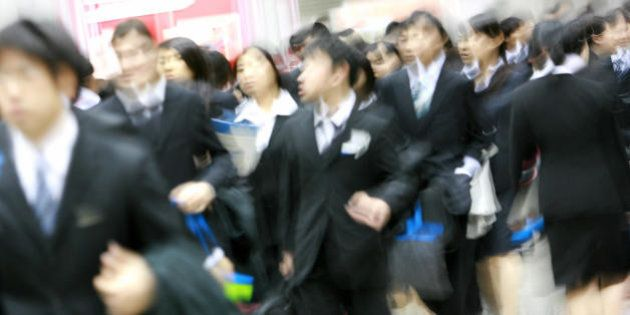 Tokyo, JAPAN: Student who will graduate from school in 2008 crowd into the job fair organised by a recruitment...